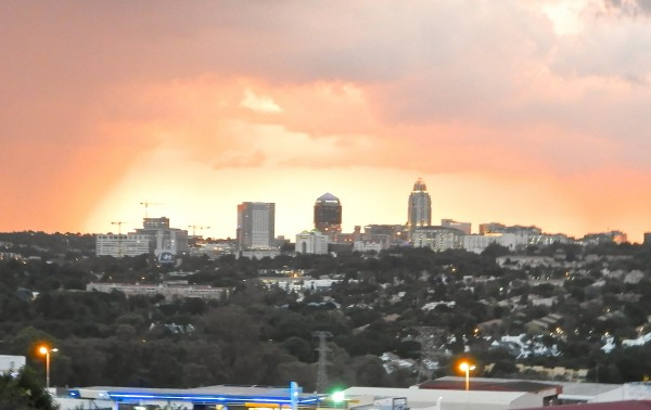 The view of Sandton Central from Katy's Palace at sunset, during a storm.